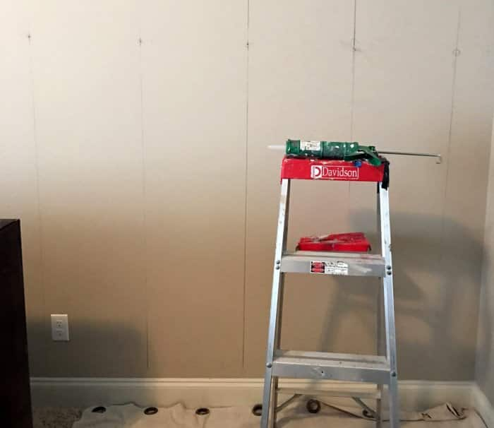 measuring wall to add wood planks