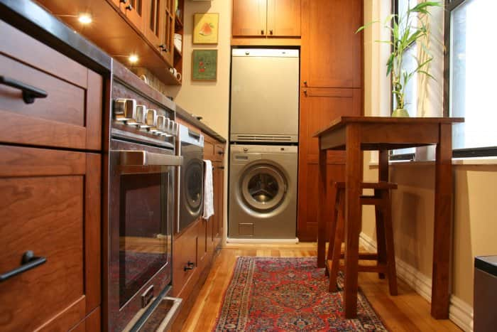 Stacked washer and dryer in kitchen