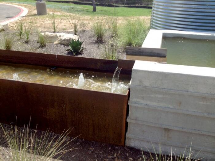 concrete water fountain in yard
