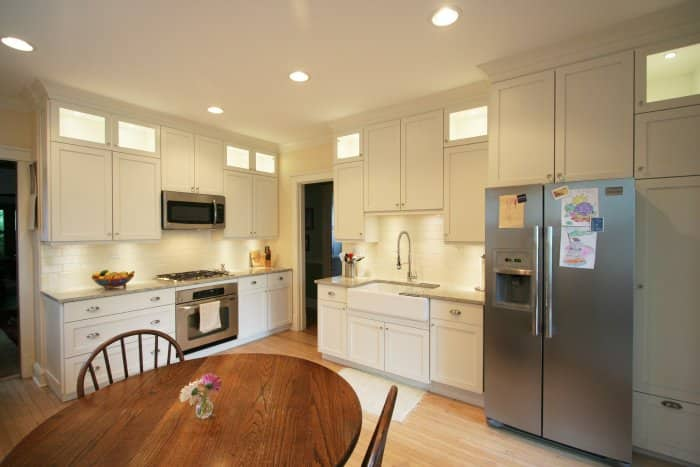 white kitchen cabinets and walls