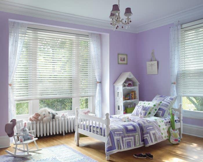 kid's bedroom with Hunter Douglas Parkland Wood Blinds