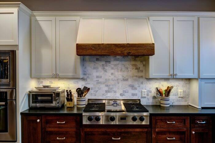 oven range hood with reclaimed wood and backsplash