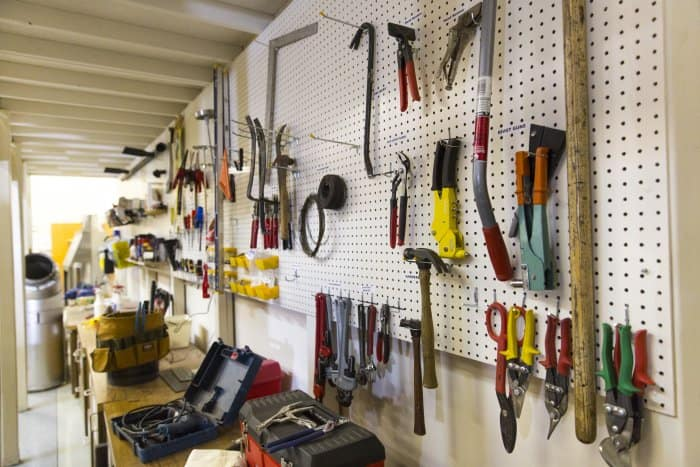 pegboard wall with tools above workbench (Photo by Eldon Lindsay)