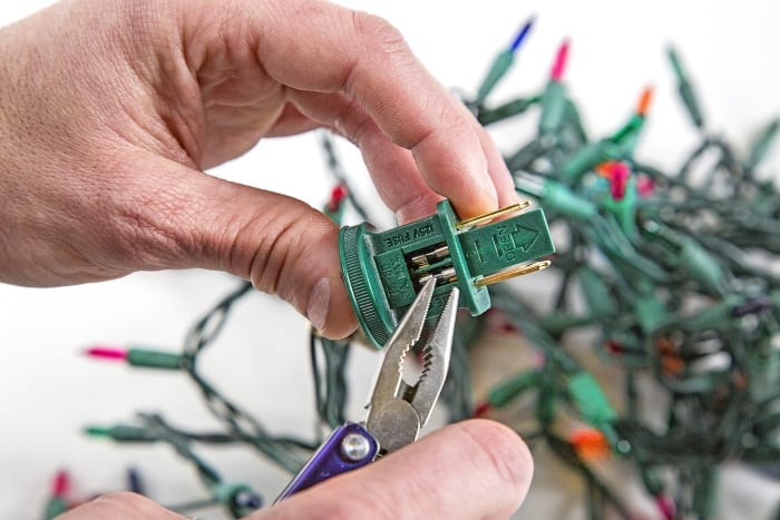 replacing a fuse in Christmas lights - How To Fix Christmas Lights Angie's List