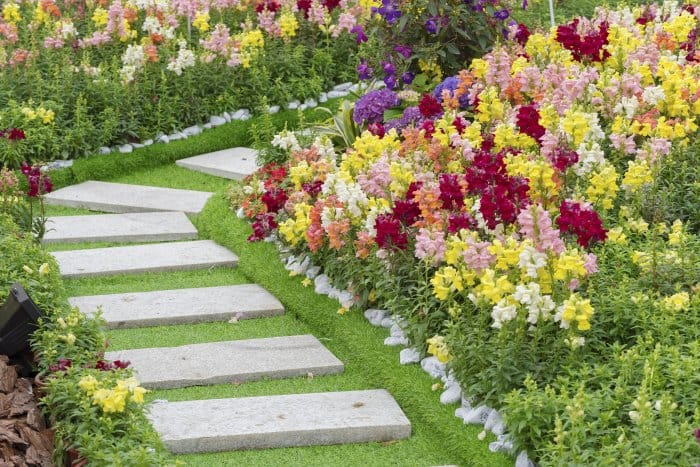 Add a stone slab walkway to stroll through your garden. (Photo courtesy of Getty Images/iStock Photos)