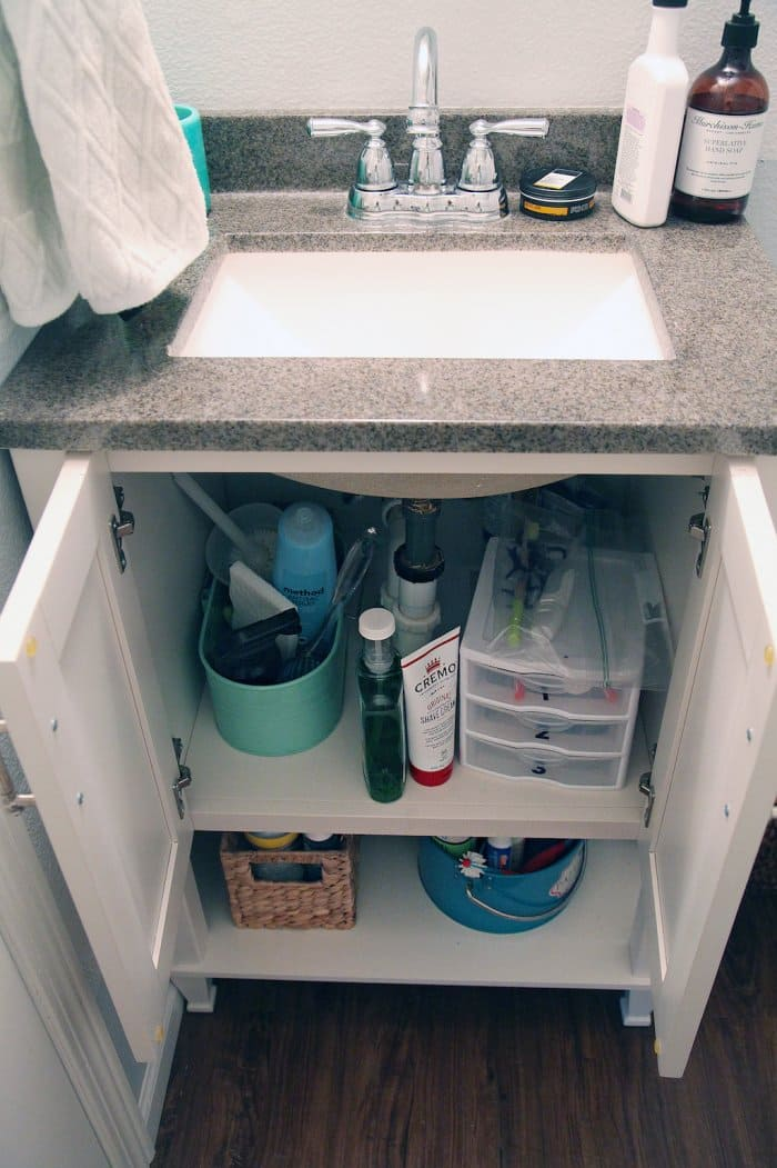 The minimal storage space available wasn't enough for this packed bathroom. (Photo courtesy of Jennifer Jones/iHeart Organizing)