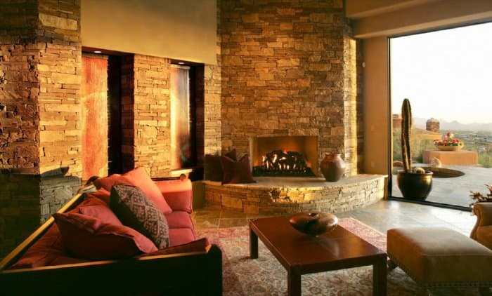 Stone columns tied in the fireplace and added a rustic look to the family room. (Photo courtesy of FallingWater)