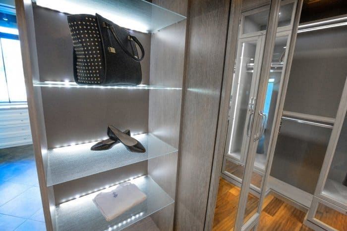 California Closets Closet With LED Shelf Lighting