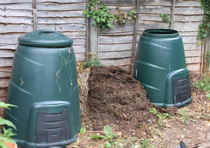 Compost bins and pile in a backyard