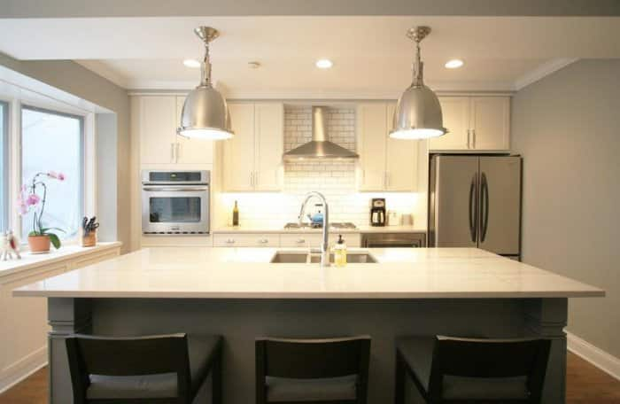 Kitchen With Large Chrome Pendant Lights