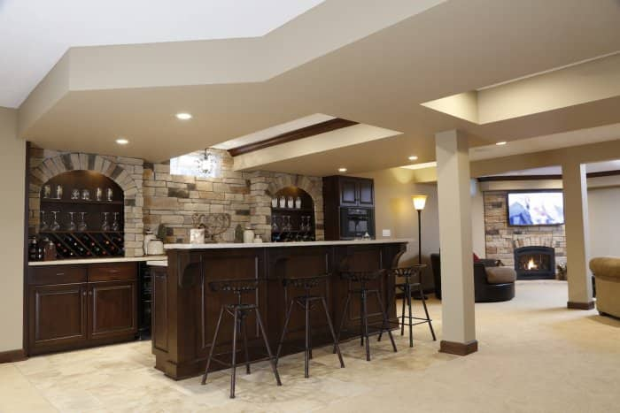 basement bar with stone detailing on wall