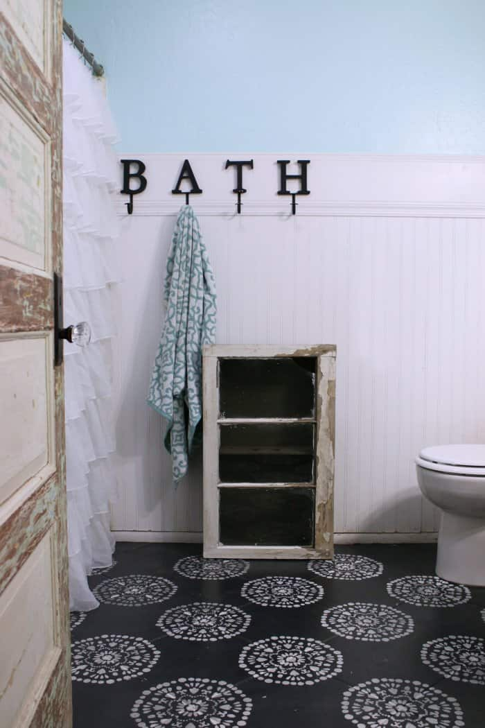 A bathroom cabinet is the perfect addition to a farmhouse bathroom. (Photo courtesy of Lolly Jane)