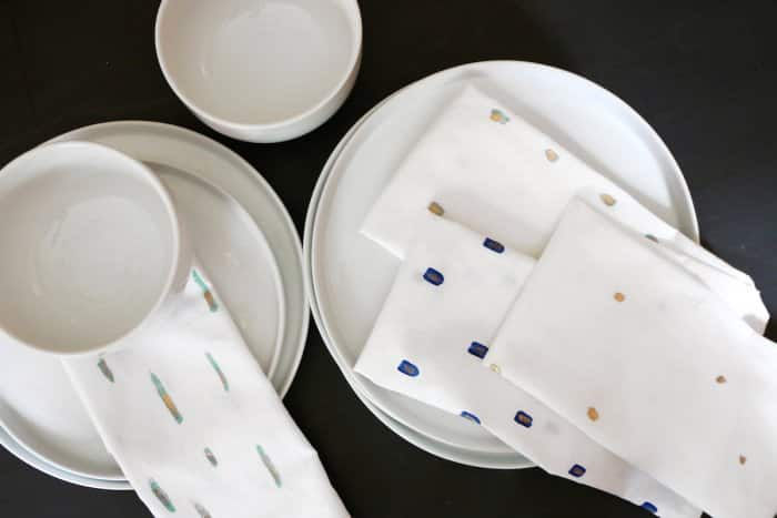 painted cloth napkins at place settings on table