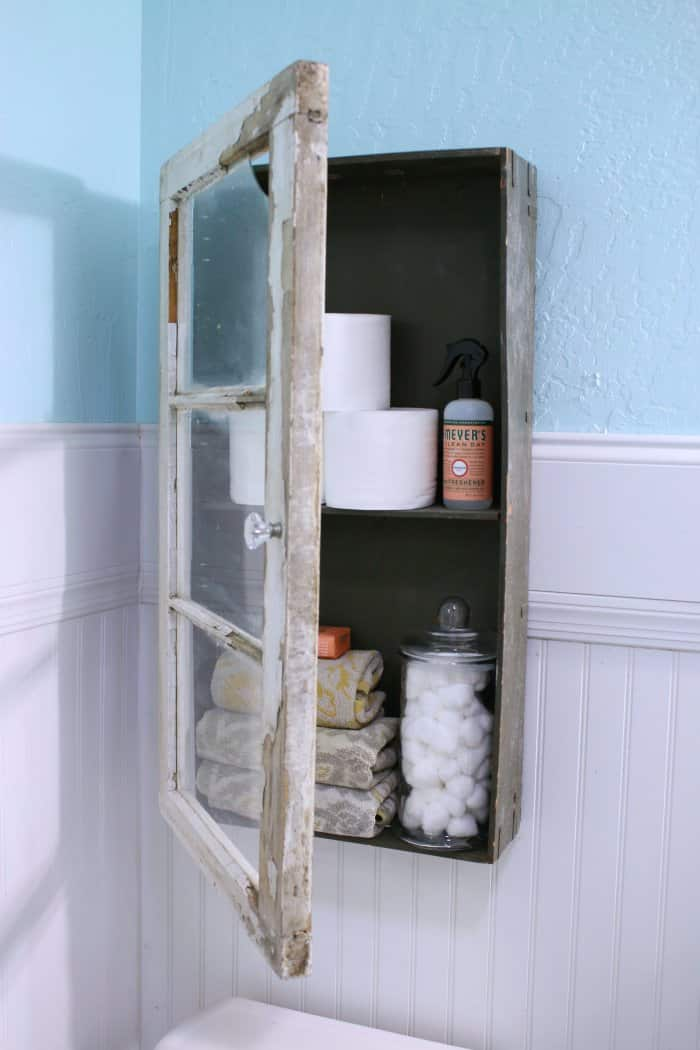 This rustic cabinet looks beautiful with white bead board and a blue wall. (Photo courtesy of Lolly Jane)