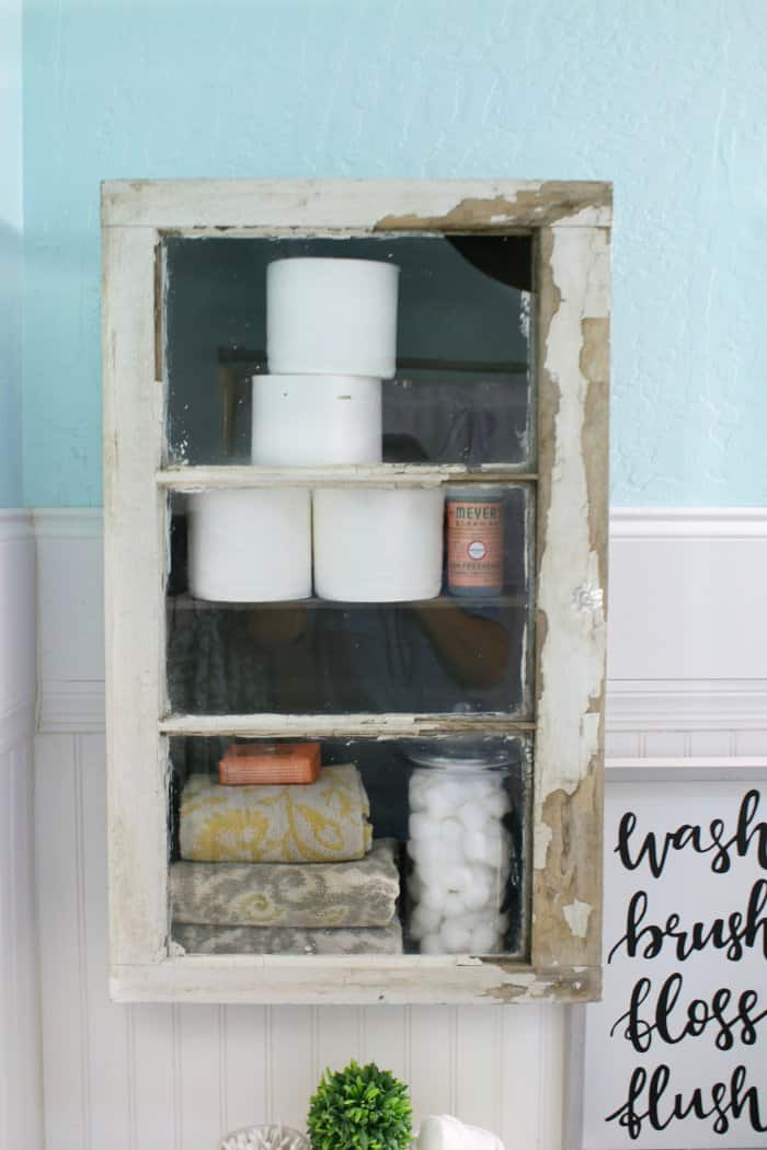 A rustic cabinet added instant storage and style to a small bathroom. (Photo courtesy of Lolly Jane)