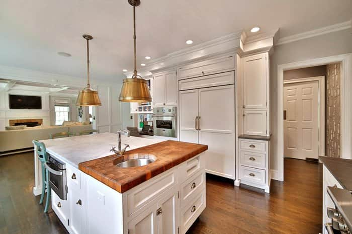 kitchen island with butcher block and marble