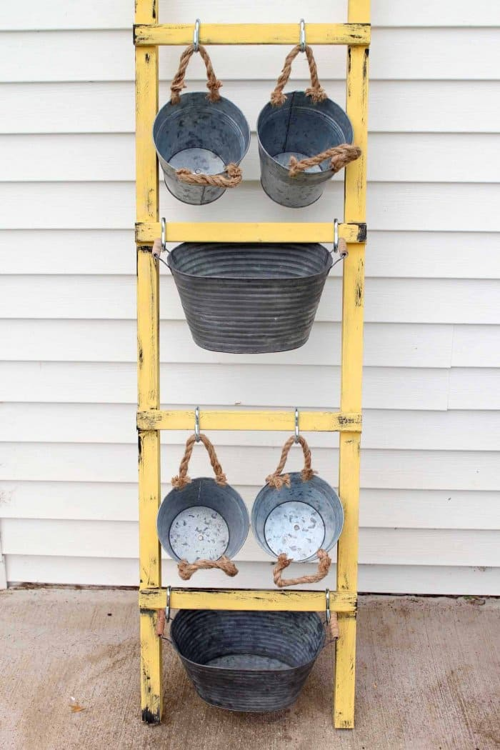 You can add more containers by using a taller ladder. (Photo courtesy of Angie Holden/The Country Chic Cottage)
