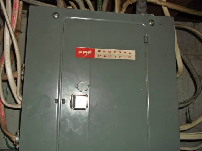 Federal Pacific circuit breaker box with connecting wires in home