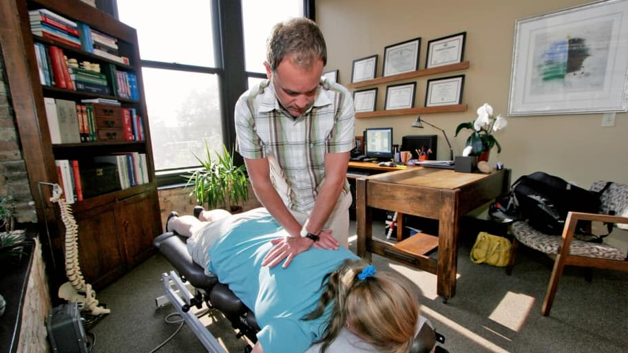 chiropractor making neck and back ajdustment