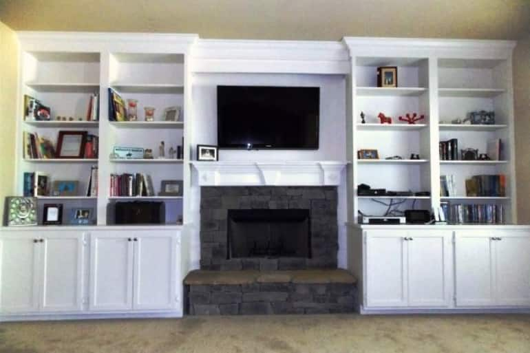 A new mom moving into her first home works with a handyman to liven a bland room with a built-in bookshelf and storage surrounding a fireplace.