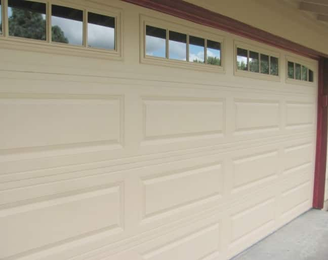 Door cost garage door panel replacement for How much does a garage door repair cost