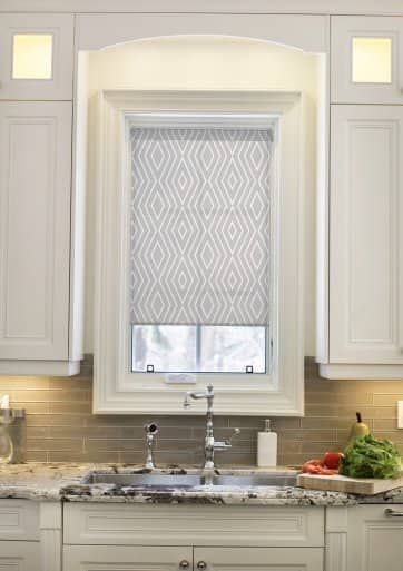 Roller shades are sleek and often customizable. (Photo courtesy of  Blindsgalore). flowered window valance