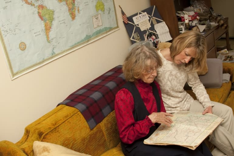 Sue Staples (right) of Home Instead Senior Care on East 86th Street helps client Barbara Toby with daily activities.