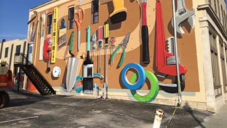 Angie's List mural depicts pegboard of tools.