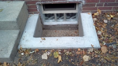 small basement window and concrete window well