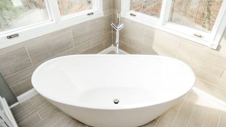 Awesome White Ceramic Bathtub In Corner Of Bathroom With Windows Above