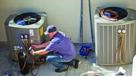 HVAC contractor installs air conditioner