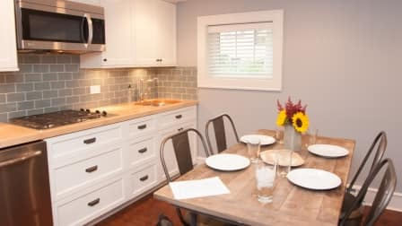 basement kitchen remodel with stove and subway tile for family