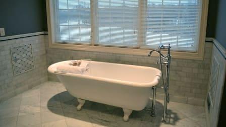 refinished bathtub in remodeled bathroom