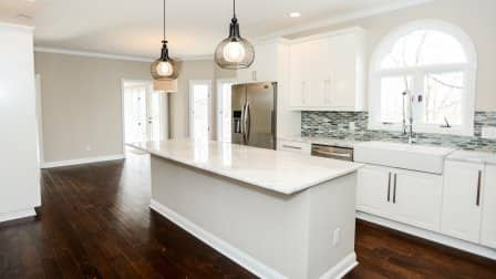 vacant white kitchen with island