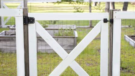 Build your own garden fence and gate for some simple charm. (Photo courtesy of Jamie Lott/Southern Revival)