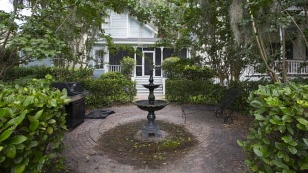 Backyard brick patio with fountain in Savannah, Georgia.