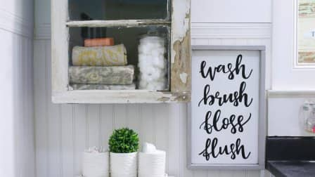 Add more storage and a dash of rustic charm to your bathroom with a DIY bathroom cabinet. (Photo courtesy of Lolly Jane)