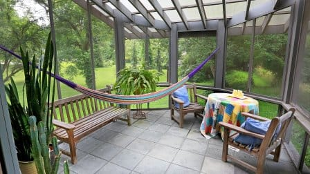 Home additions such as this sunroom can add function and great spaces for your family. But how much do they typically cost? Photo by Frank Espich