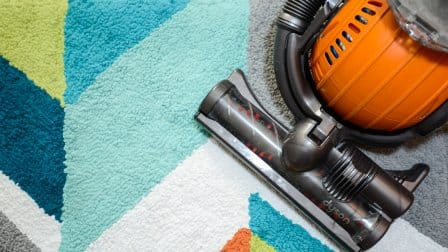 vacuum on colorful rug