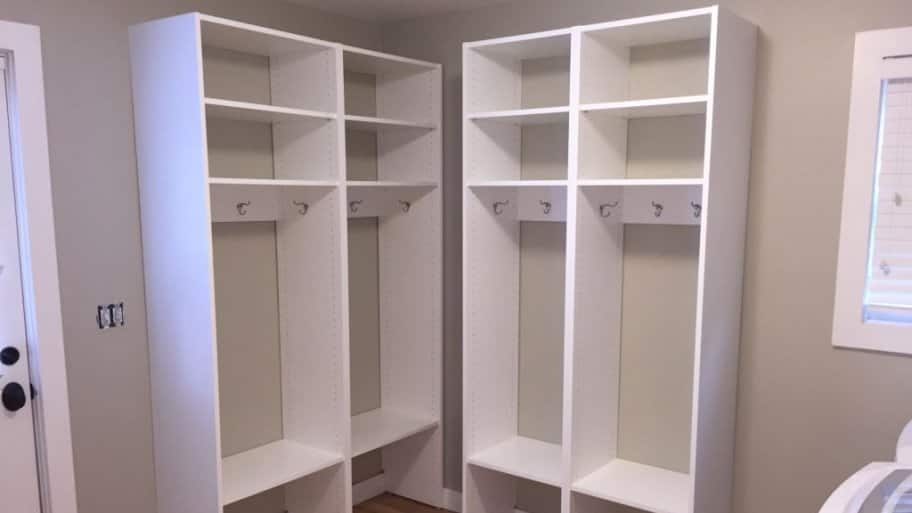 Open storage closets in a laundry room.