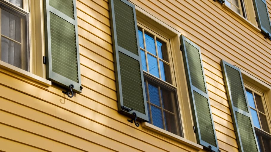 green shutters on windows on house exterior