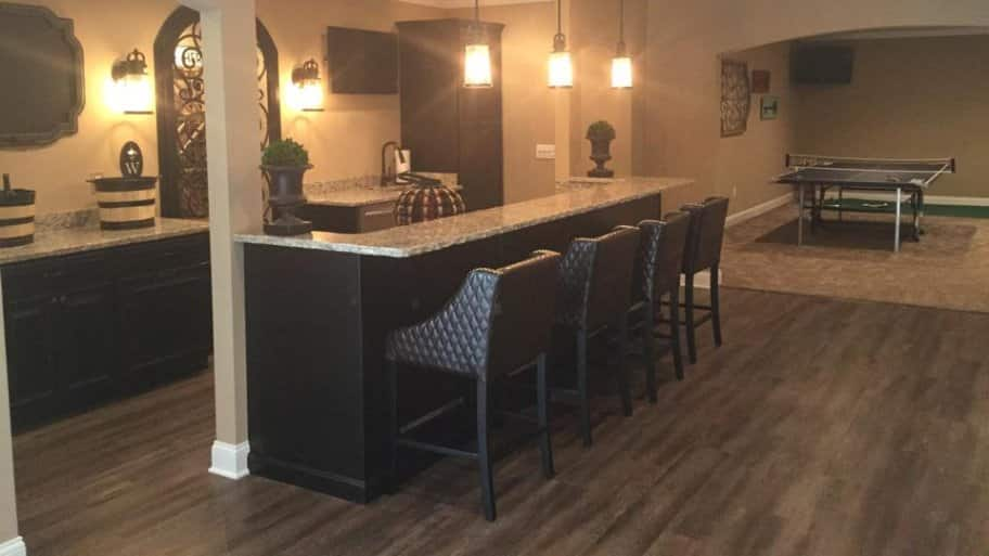 Laminate is just one of several good basement flooring options you can choose for your remodeling project. (Photo courtesy of Joe Zago) : basement floors options  - Aeropaca.Org