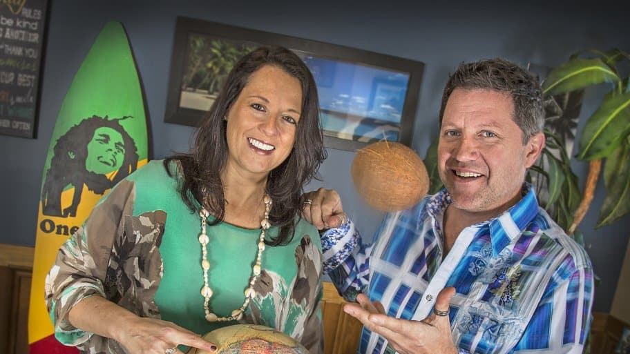 couple holding globe and tossing a coconut