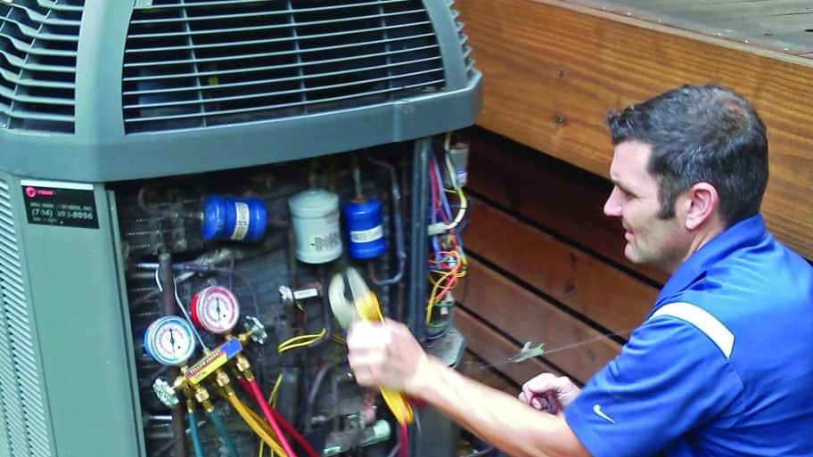 technician testing heat pump