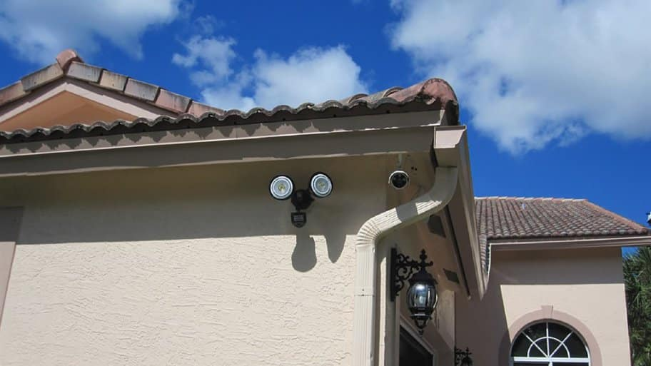 Motion lights and camera on the side of a home