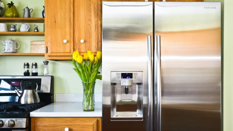 Stainless steel refrigerator in a home kitchen