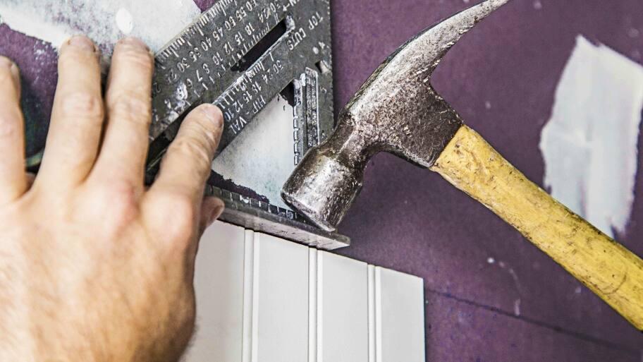 carpenter at work with hammer