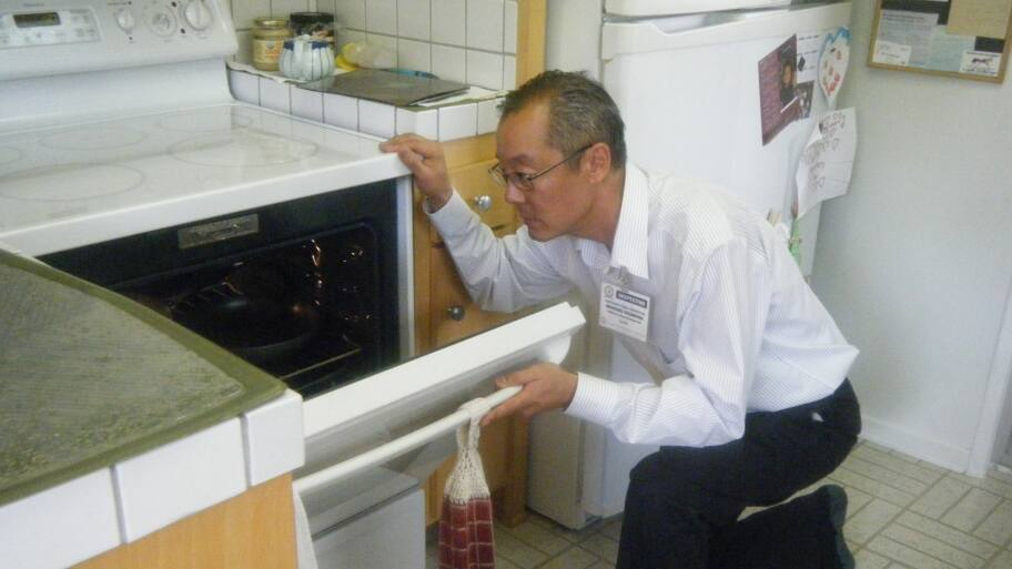 home inspector inspects oven