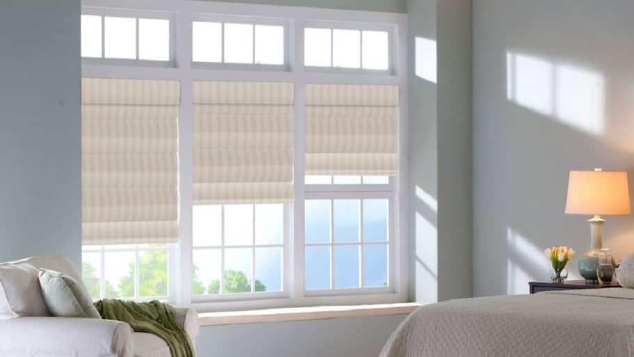 windows with striped Roman shades