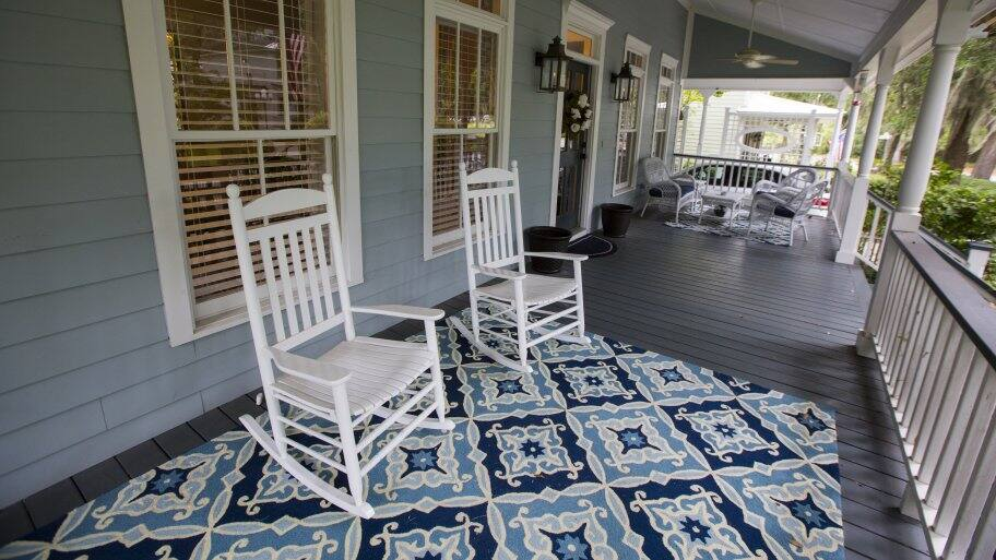 large front porch with rocking chairs and area rug (Photo by Mike Fender)